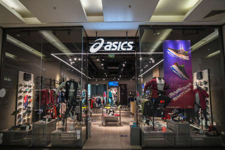 Skopje, North Macedonia - March 12, 2021: Asics store in Skopje, North Macedonia. Asics is a Japanese multinational company which produces footwear and sports equipment Sajtókép
