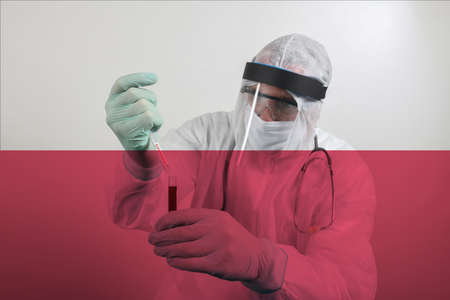 Doctor wearing respiratory mask and holding the Coronavirus Covid-19 blood sample. Scientists test for Covid-19 or Corona virus By using science tubes to research and treat illness in a lab or hospital. Transparent flag of Poland over the photo