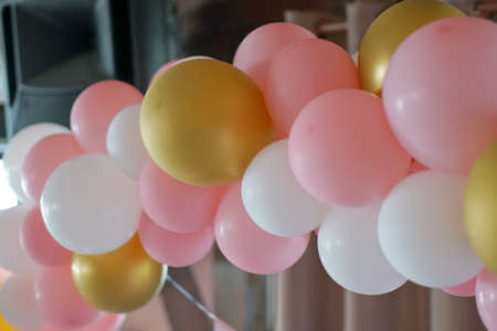 Many colorful balloons decorated wall as background. Beautiful background with colorful balloons. Birthday style party