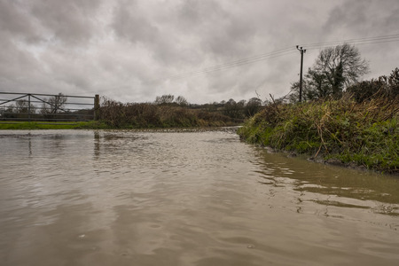 The morning after Storm Ana hit, a flooded farm road in East Sussex