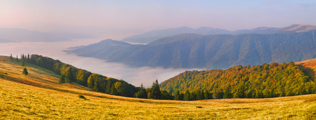 Landscape-view of the mountains at sunrise with sea fog in the valley. Europe, Ukraine, Carpathian Mountains.