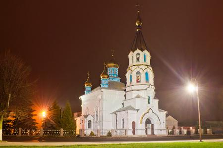 Church in the light of evening lanterns. St. Ilyinskaya Church in Dubno, Ukraine Stock Photo