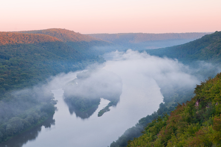 Top view on the beautiful islands of Yin-Yan on the Dniester River (Dnestr). Morning fog over the river. National Nature Park Dniester Canyon, Seven Wonders of Ukraine