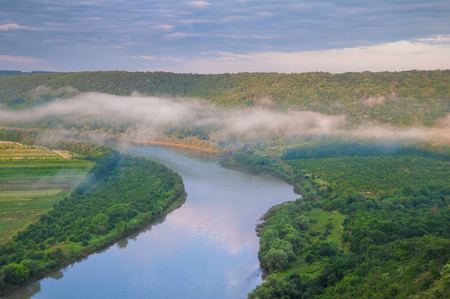 Beautiful summer landscape with fog over the river. Dniester Canyon, Ukraine, Europe