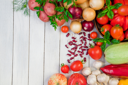 Fresh vegetables and fruits on a white wooden table