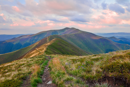 View of the mountain range at sunrise. Summer mountain landscape Stock Photo