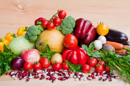 Fresh organic vegetables on a wooden background Stock Photo