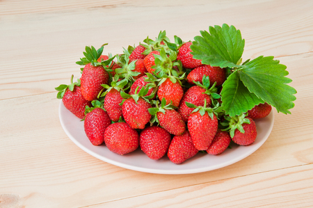 Fresh strawberries on wooden table Stock Photo