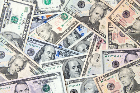 Banknotes of dollars different denominations. Business abstract background Stock Photo