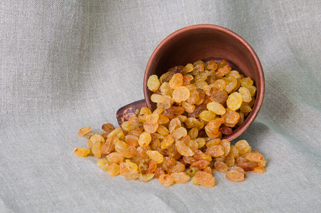 Sweet raisins are scattered from the cup