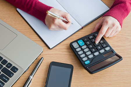 Woman calculating with a calculator