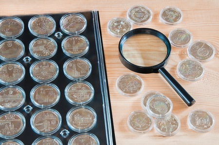 Page numismatic album for coins in capsules Stock Photo