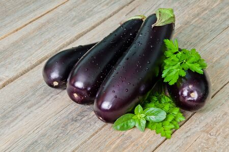 Fresh ripe eggplants on a wooden table