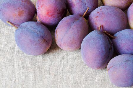 Closeup of blue plums on burlap