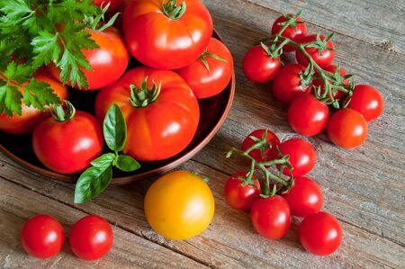 Fresh organic tomatoes on a wooden table Фото со стока