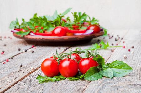 Fresh ripe tomatoes on a wooden table Фото со стока
