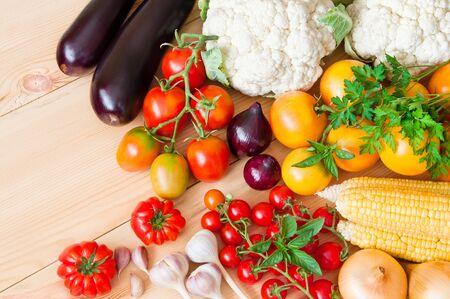 Fresh organic vegetables on a wooden table Фото со стока