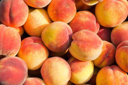Background of fresh ripe organic peaches