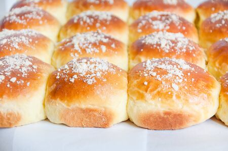 Freshly baked buns with white sprinkle