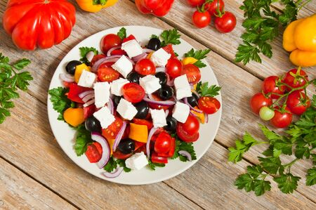 Mediterranean salad with feta cheese, tomatoes and olives Фото со стока