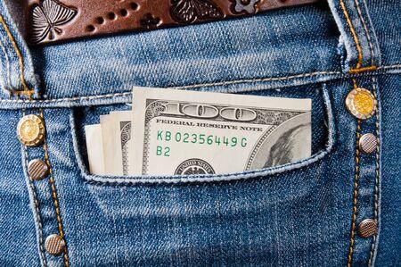 Dollar banknotes in the pocket of jeans  Banco de Imagens