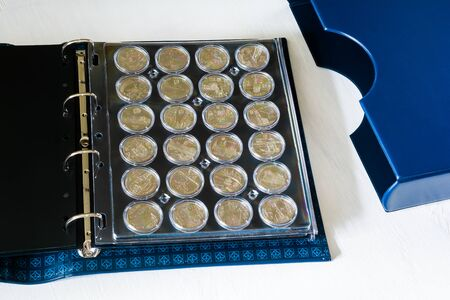 Large album for collectible coins in capsules Stock Photo