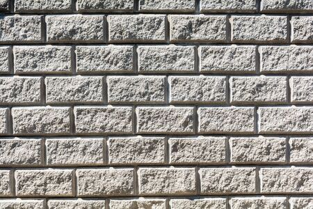 The texture of a stone wall of rectangular stones Stock Photo