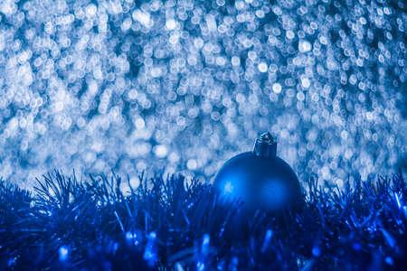 Christmas ball on blue abstract bokeh background