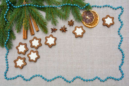 Decorative Christmas background with spruce branches, gingerbread and decorations Stock Photo