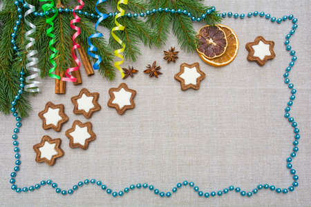 Decorative Christmas background with spruce branches, serpentine, gingerbread and decorations