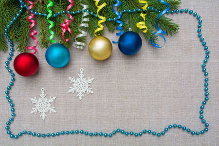 Decorative Christmas background with spruce branches, Christmas balls and decorations