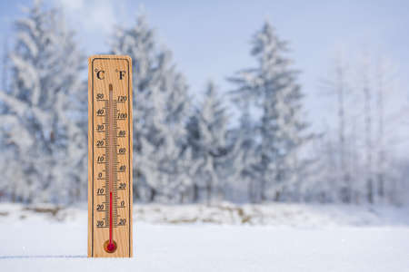 The thermometer in frosty sunny weather shows a low temperature