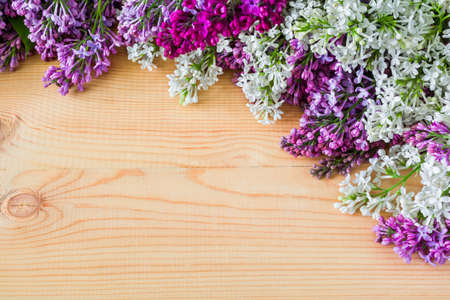 Colorful lilac flowers on wooden background Stock Photo
