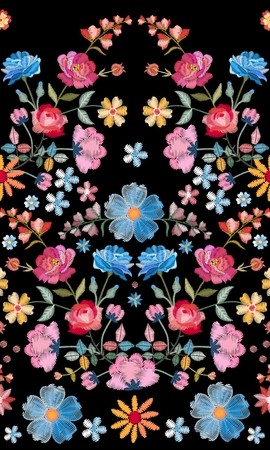 Embroidery seamless pattern. Beautiful summer flowers and leaves on black background. Multicolor embroidered print. Fashion design.