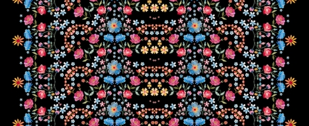 Embroidery seamless pattern. Beautiful vertical line with colorful summer flowers on black background. Embroidered print. Fashion design.