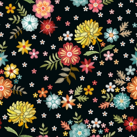 Embroidery design. Cute seamless pattern with floral ornament. Embroidered colorful flowers on black background.