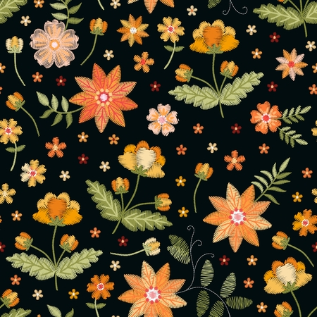 Embroidery seamless print with orange and yellow flowers on black background. Fashion print.