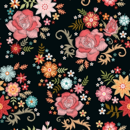 Embroidery seamless pattern with beautiful flowers on black background. Fashion design for fabric, textile, wrapping paper. Fancywork print.