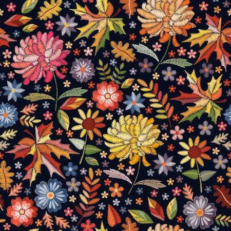 Colorful seamless pattern with embroidered flowers and leaves. Bright embroidery design on black background.
