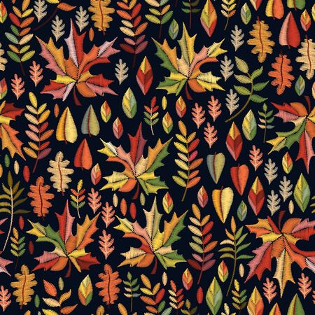 Autumn embroidery. Ditsy seamless pattern with colorful leaves on black background.