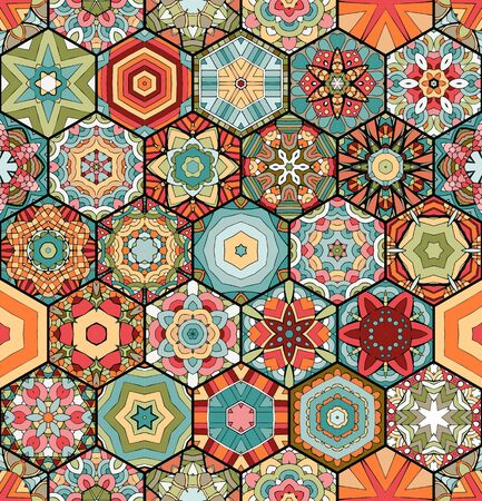 Colorful patchwork pattern. Seamless vector design. Hexagonal tiles with different ornaments.