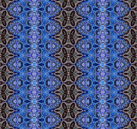 Seamless lace ornament in cobalt and sapphire tones on a brown background. Print for fabric, bedding, wallpaper. 版權商用圖片