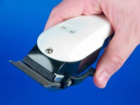 hairclipper: Hand holding hair-clipper