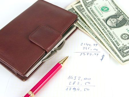 solvency: US dollars, pen and notebook