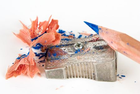 A pencil sharpener against white background photo