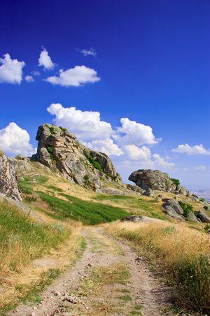 macedonia: Gravel road and rocks in Macedonia Stock Photo