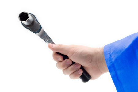 Hand holding a wrench against white background photo