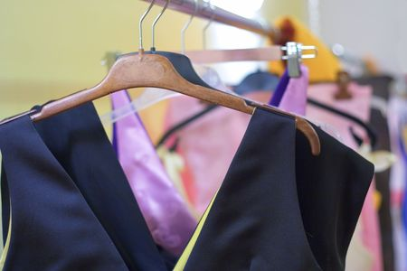Designer clothes lined up in store Stock Photo