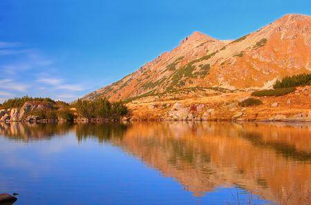A glacial lake at national park Pirin, Bulgaria photo