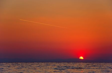 Sunrise with a plane flying on the sky in Greece Stock Photo - 430576
